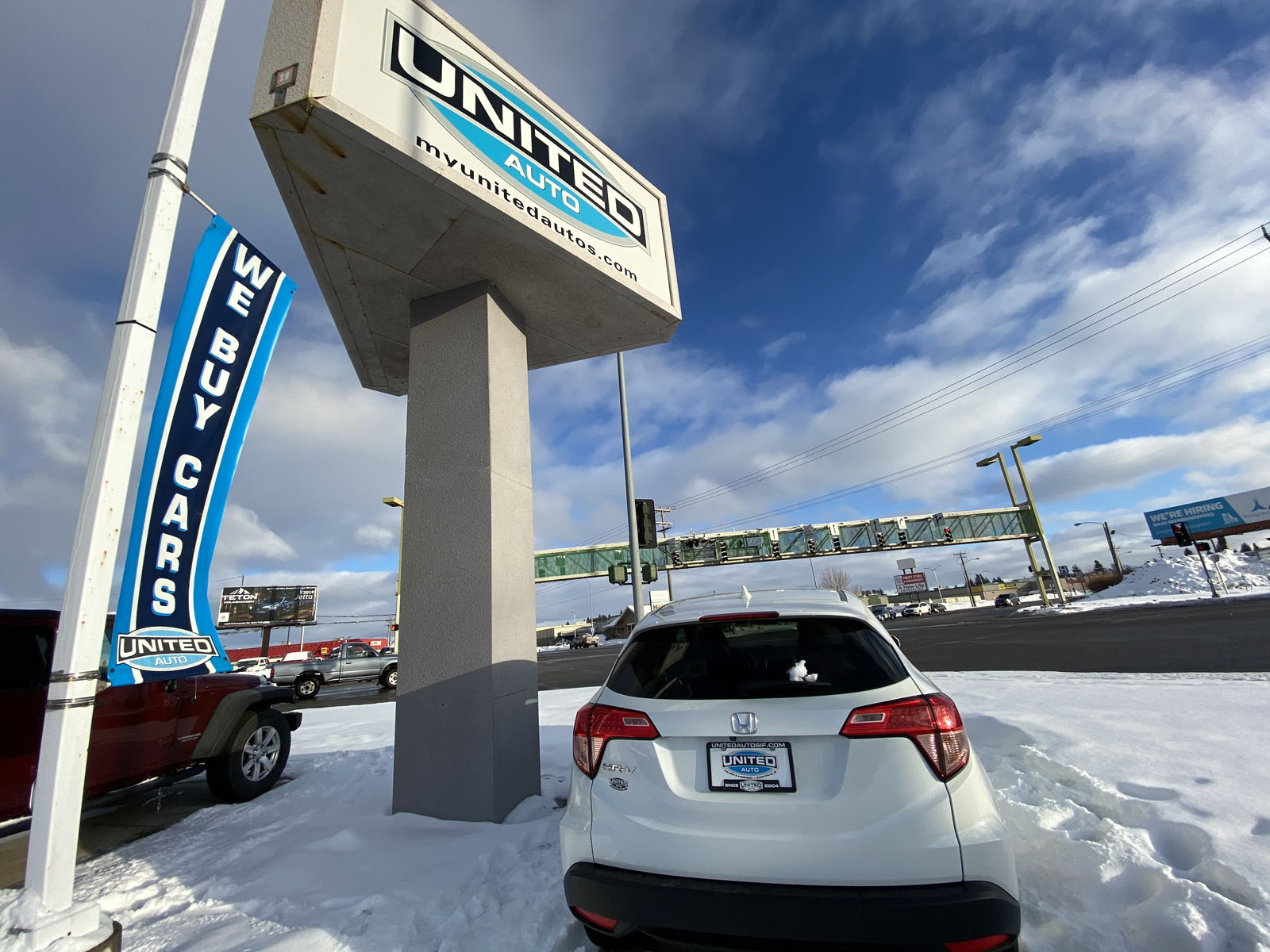 United Auto Sales car lot in winter covered with snow